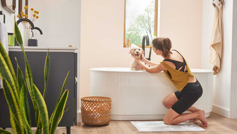 Studio S Bathtub with Woman Washing Dog
