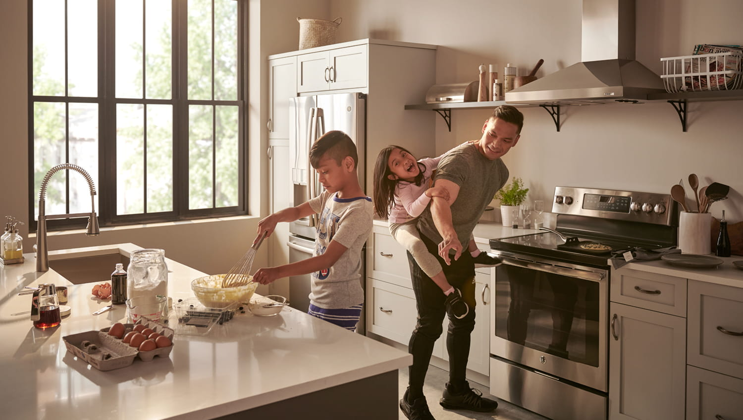 Edgewater Kitchen Faucet in Kitchen with Family Cooking