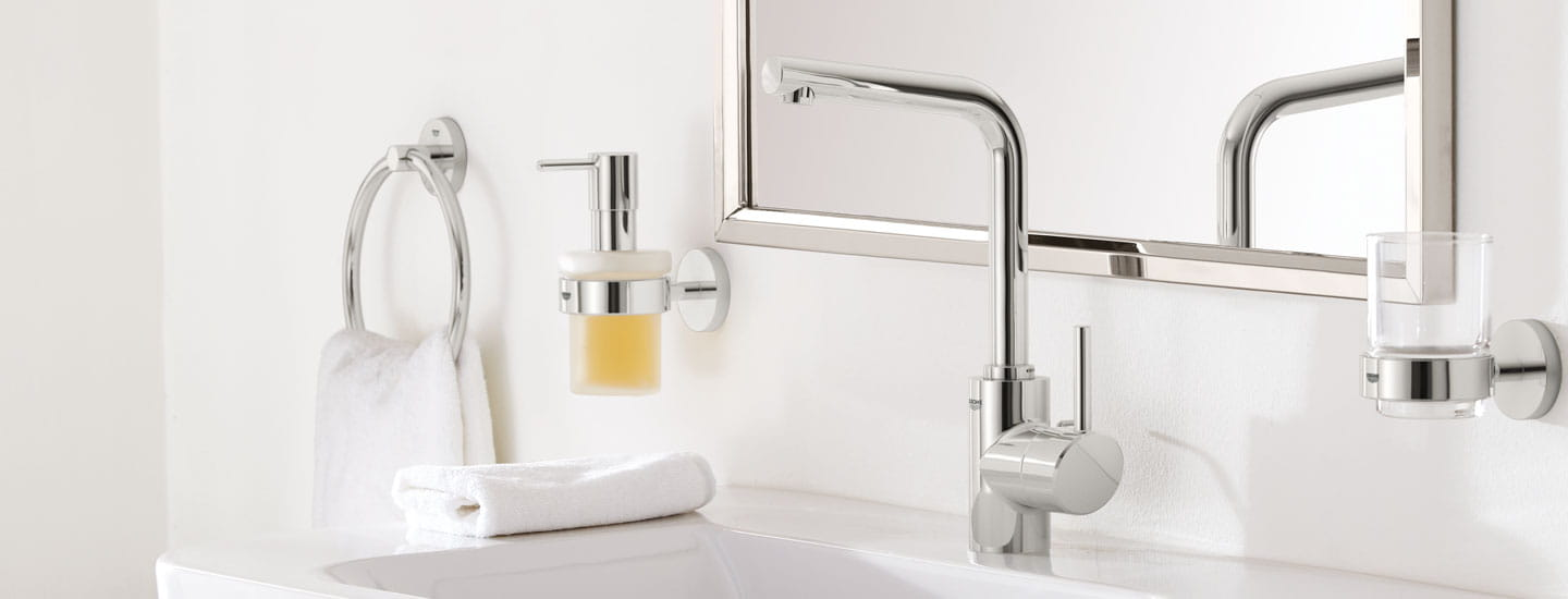 Concetto Single Handle Bathroom Faucet by GROHE in white modern bathroom with mirror