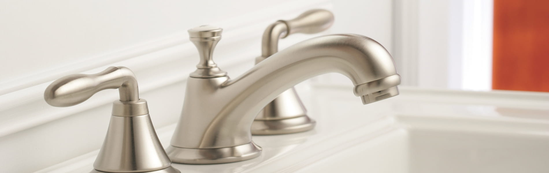 Seabury nickel bathroom faucet in a white room.