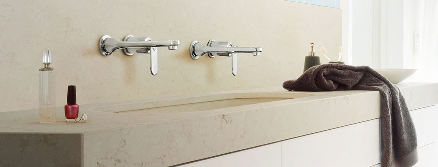 two sinks in bathroom with towel on counter