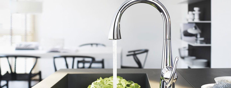 kitchen sink water running on vegetable