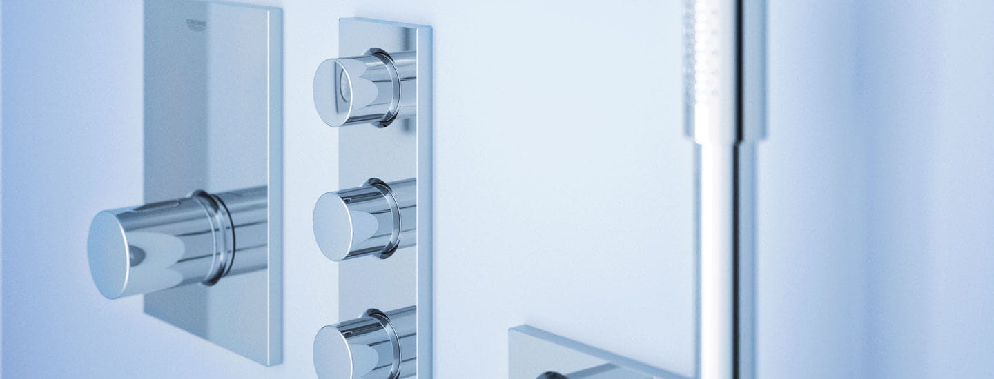 Grohtherm f thermostat knobs in a blue bathroom.