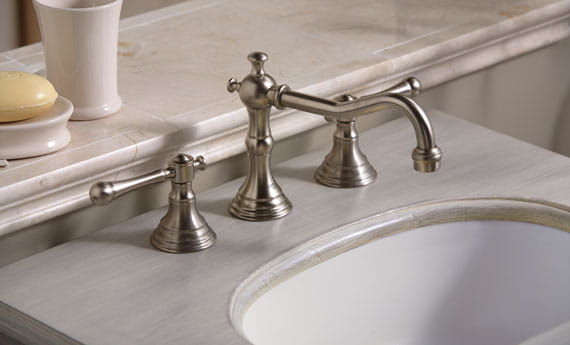 faucet and sink with marble countertop