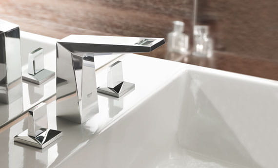 sink and faucet with wood walls