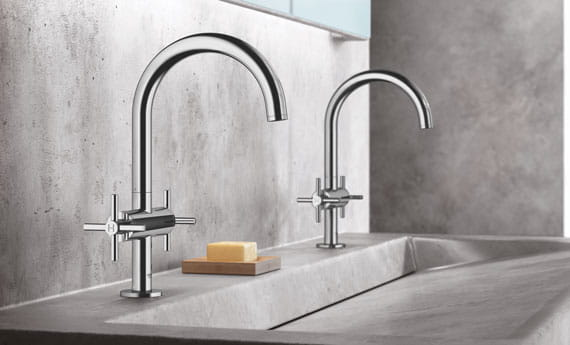 two faucets with one big marble sink
