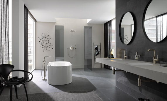 grey themed bathroom with bathtub and sinks