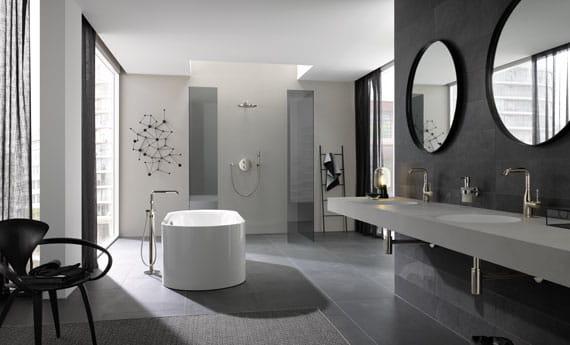 grey themed bathroom with bathtub and sinks