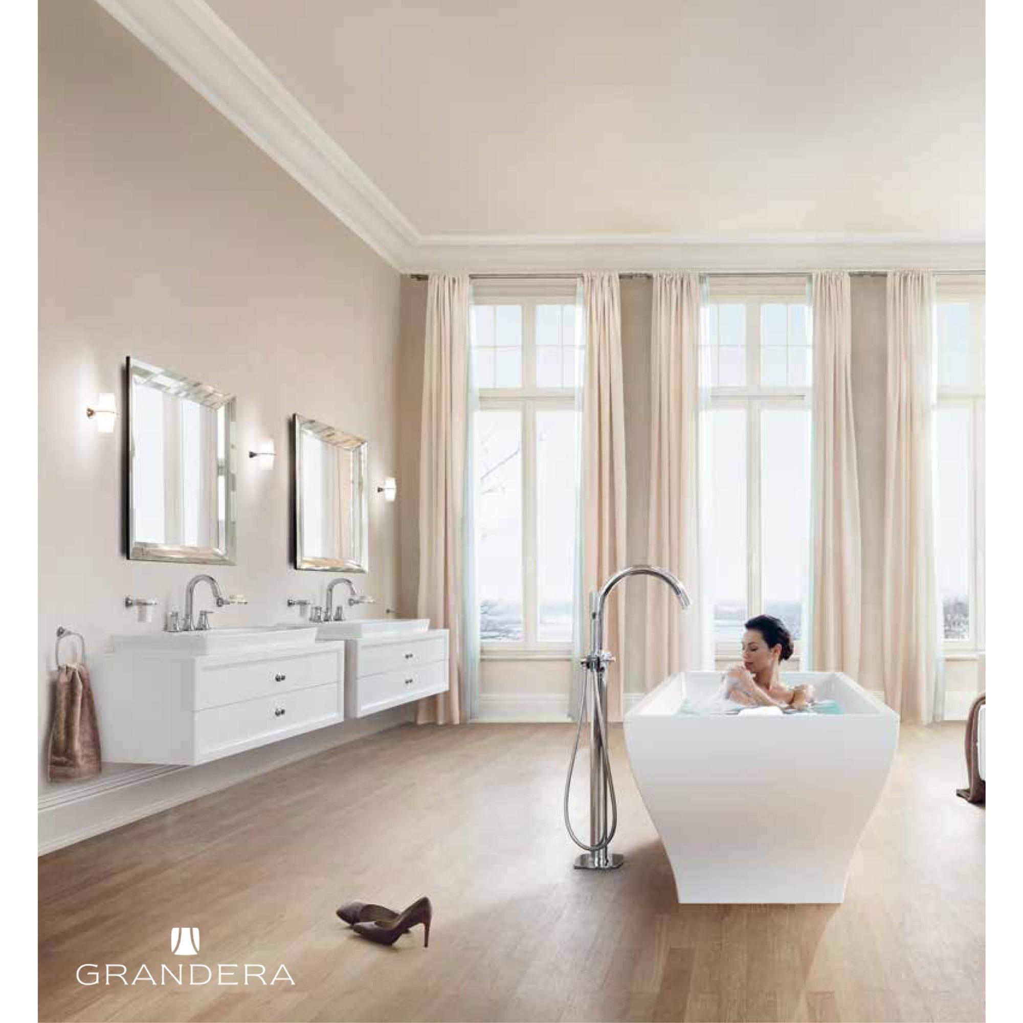tan themed bathroom with woman in bathtub