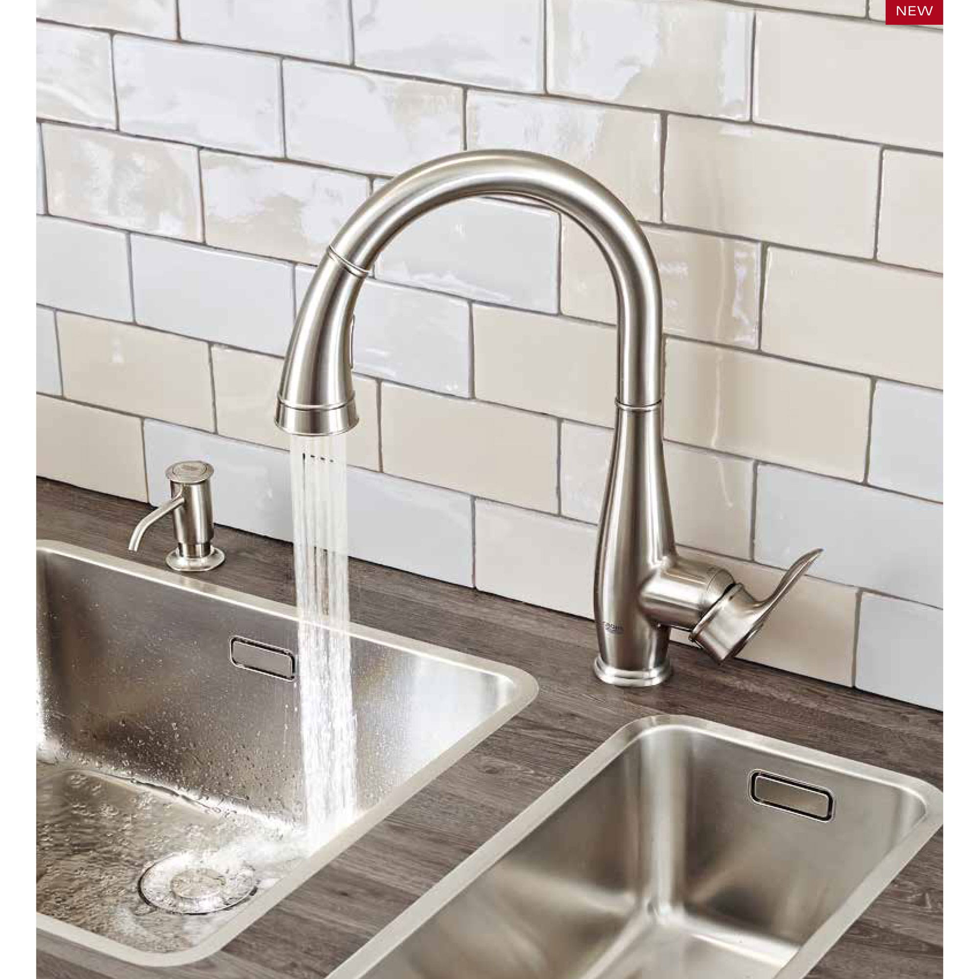 faucet with running water and white tile background