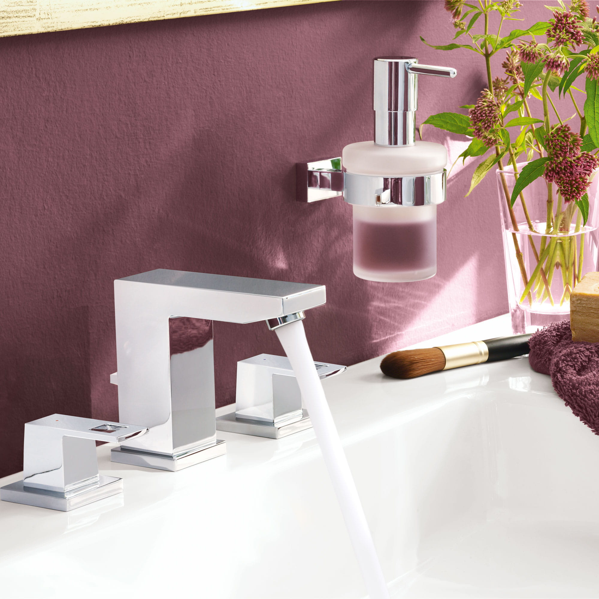 Bathroom faucet in a plum colored room.