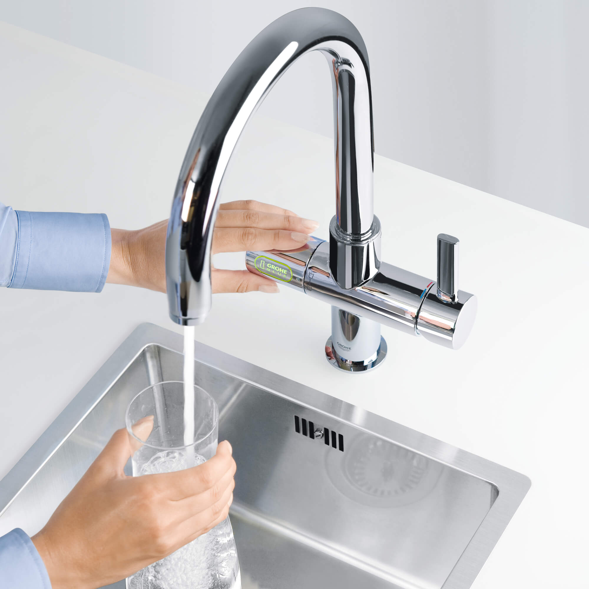 filling up water bottle with Grohe Blue faucet