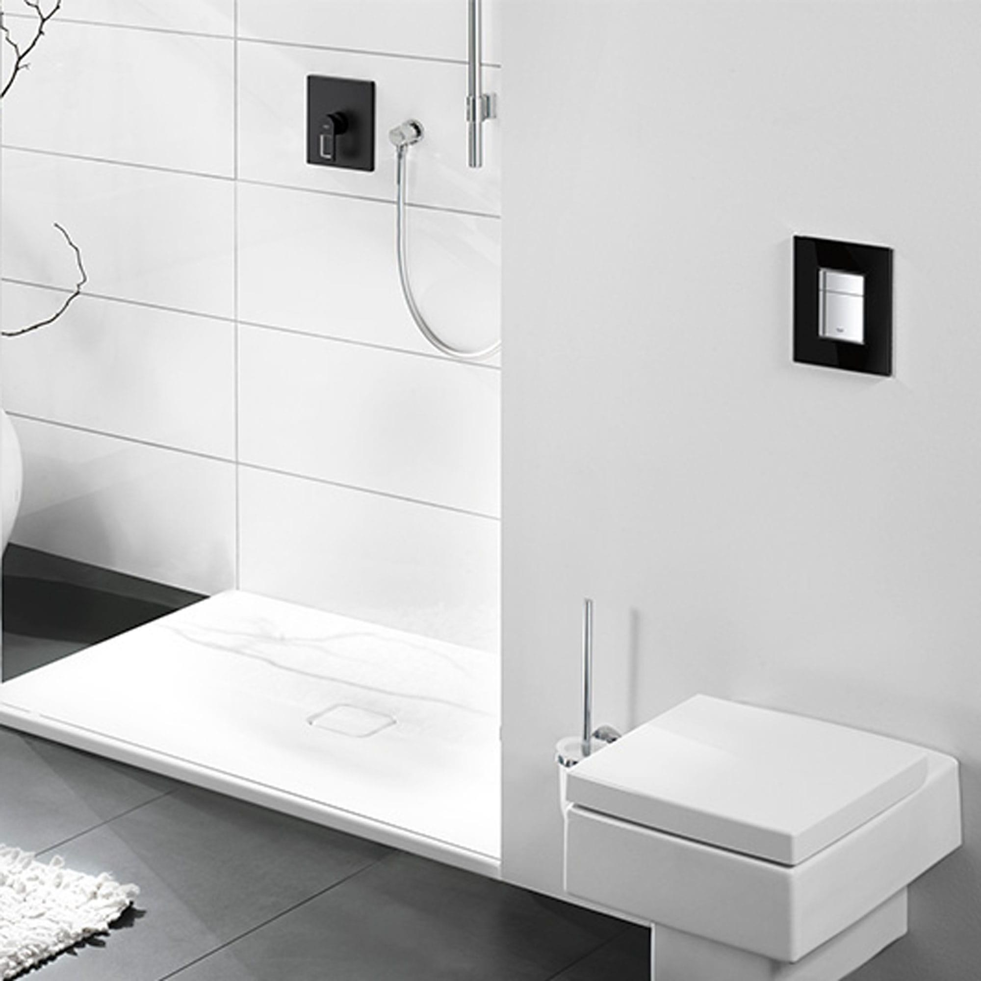 Square flush plate in a grey bathroom.