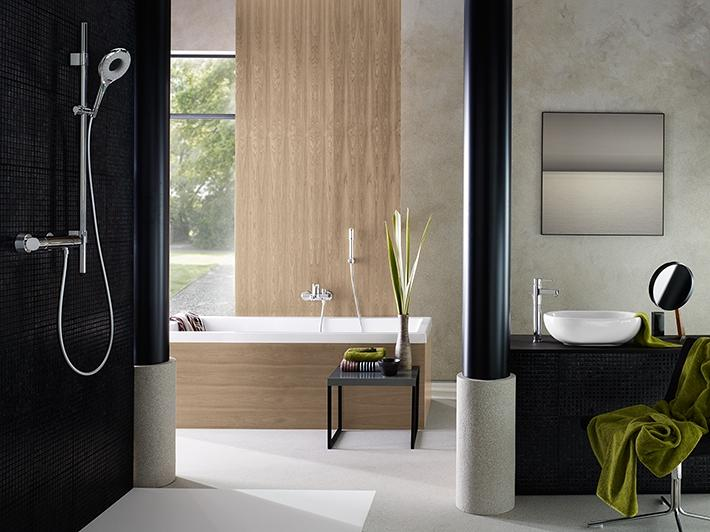 Modern bathroom setting with black tile walls and green accents
