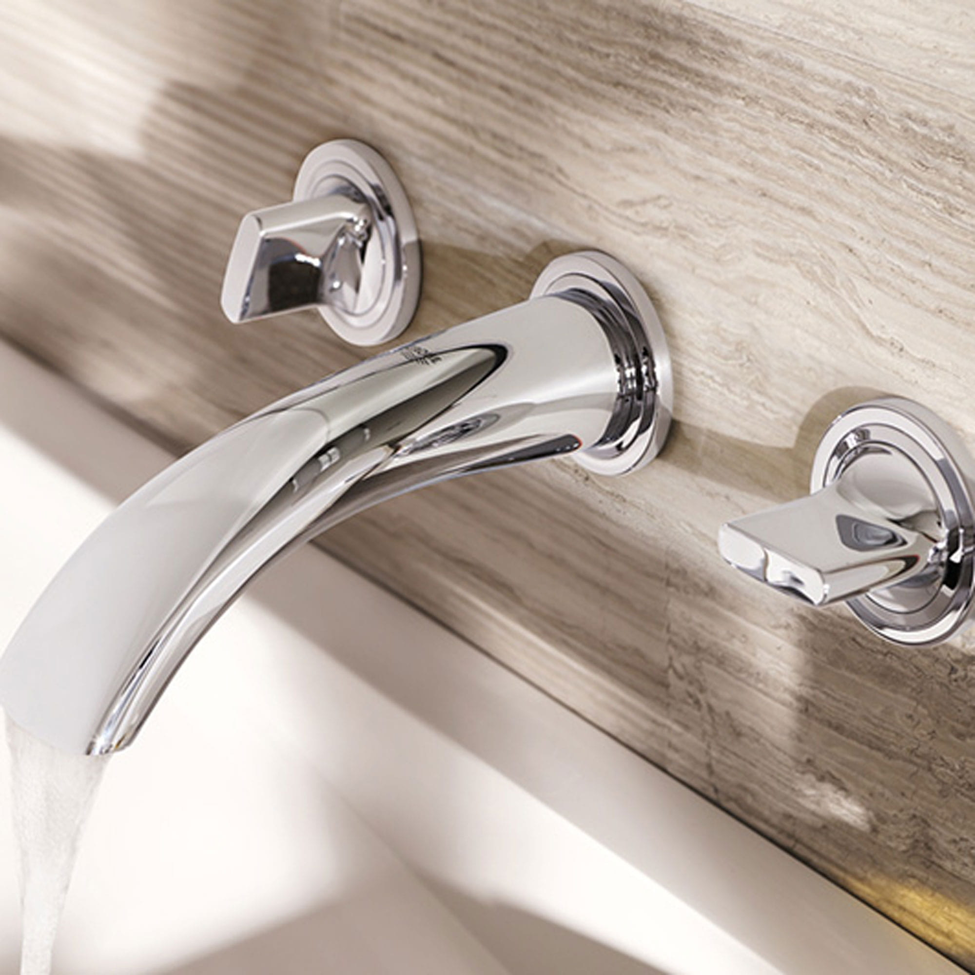 closeup on bathroom faucet with running water