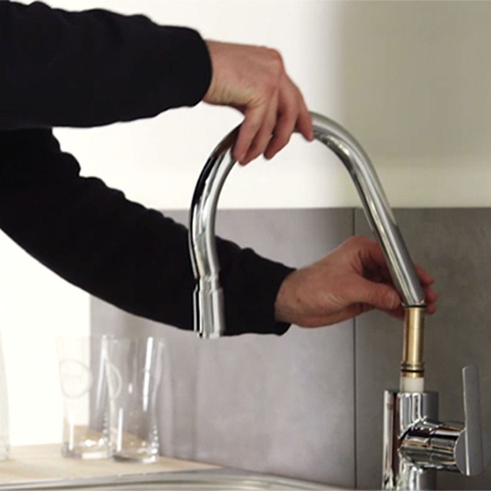 Install a kitchen faucet with pull-out spout
