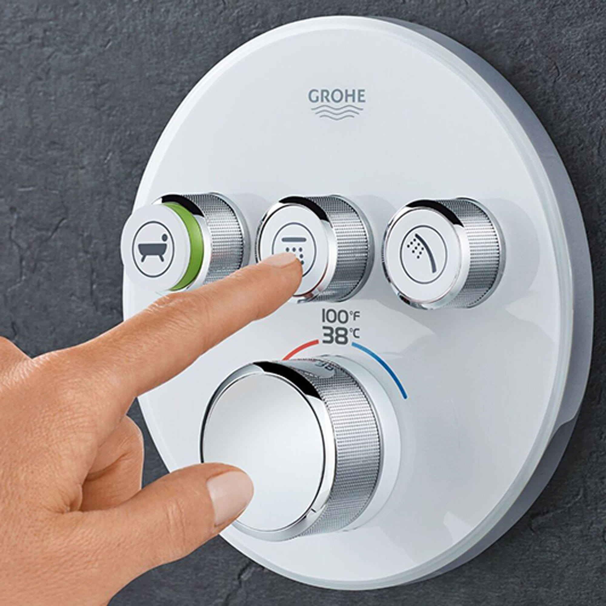 person pressing button Grohe shower knob