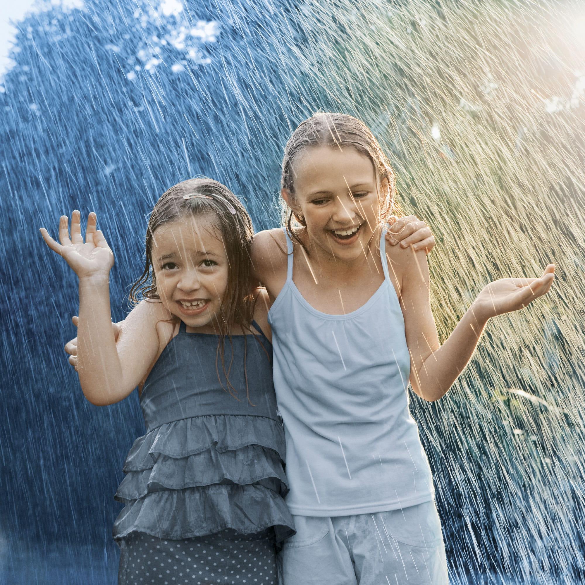 two girls in rain