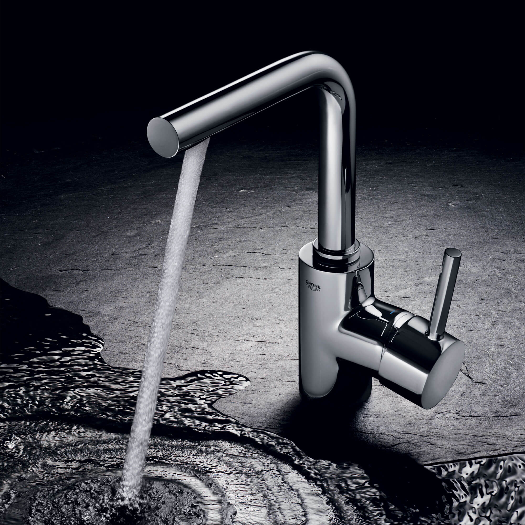 Essence bathroom faucet spraying water into a puddle.