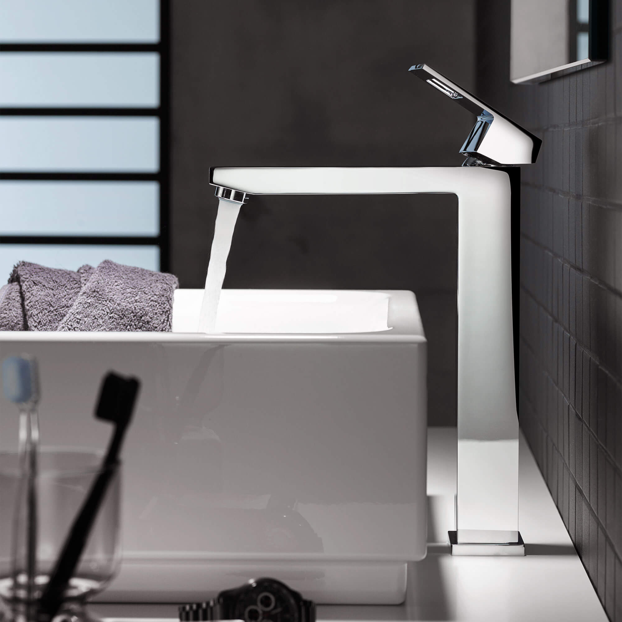 Eurocube faucet spraying water into a white sink.