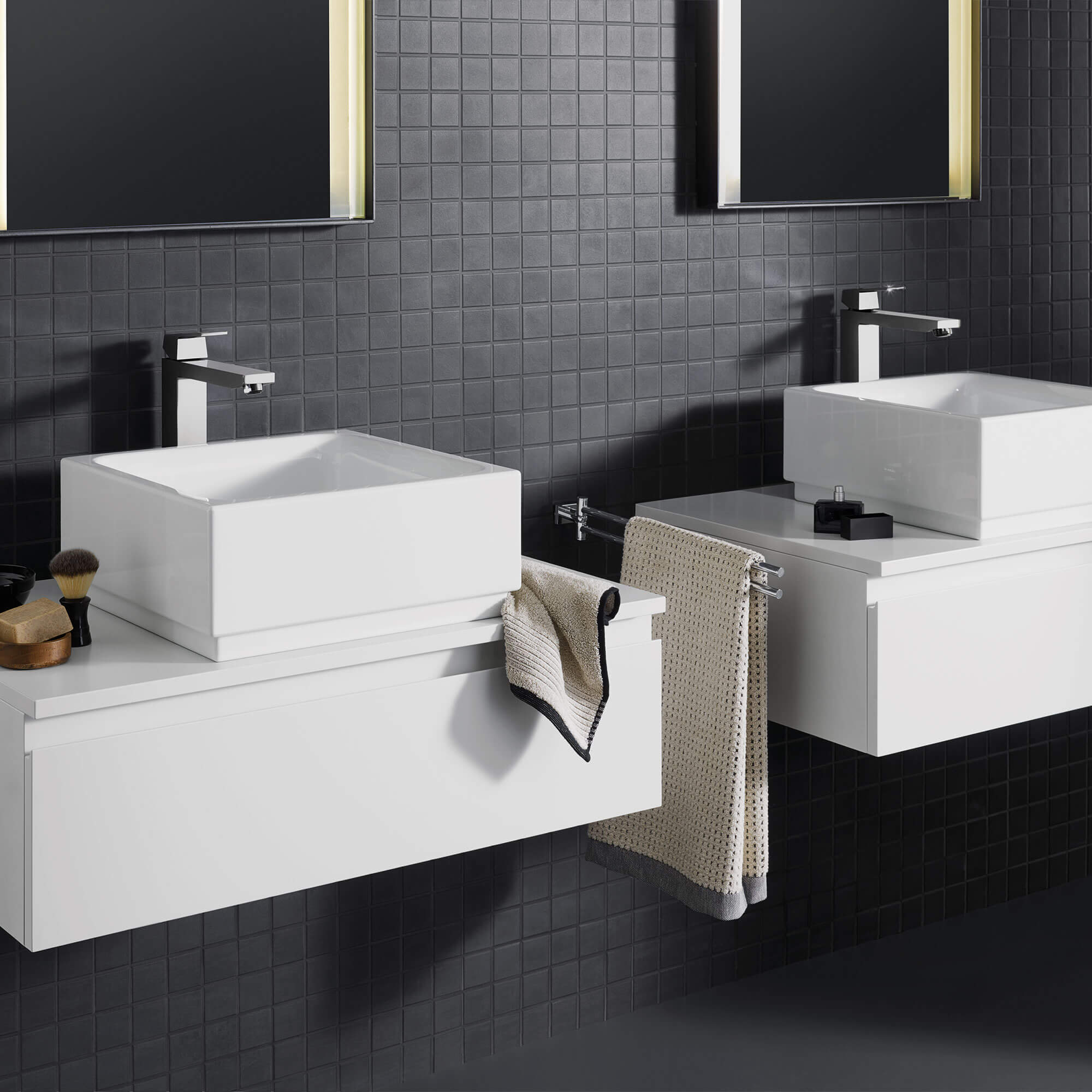 Eurocube faucet in a bathroom with black tiled walls.