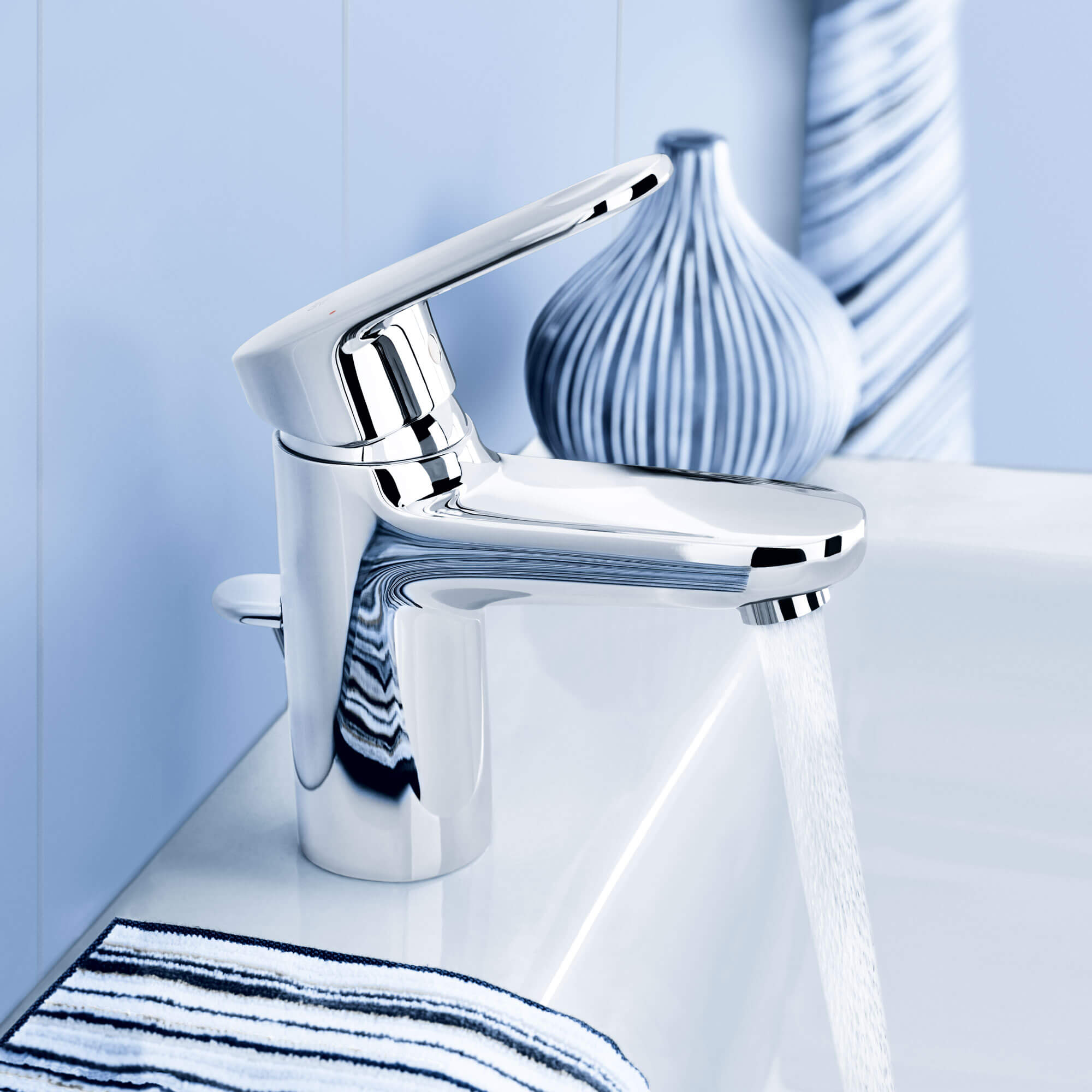 Europlus faucet in  bathroom with blue decorative designs.