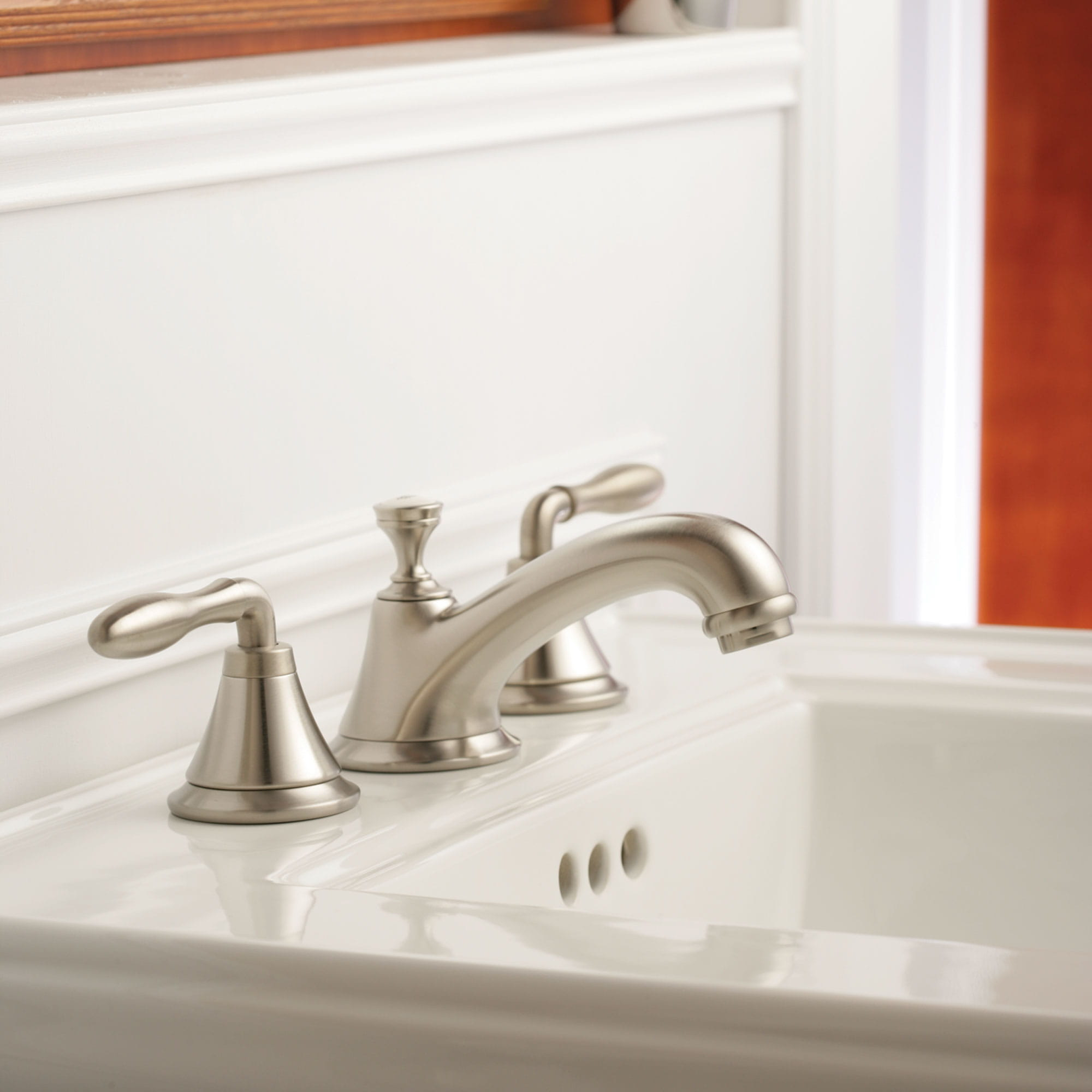 faucet with white background and white sink
