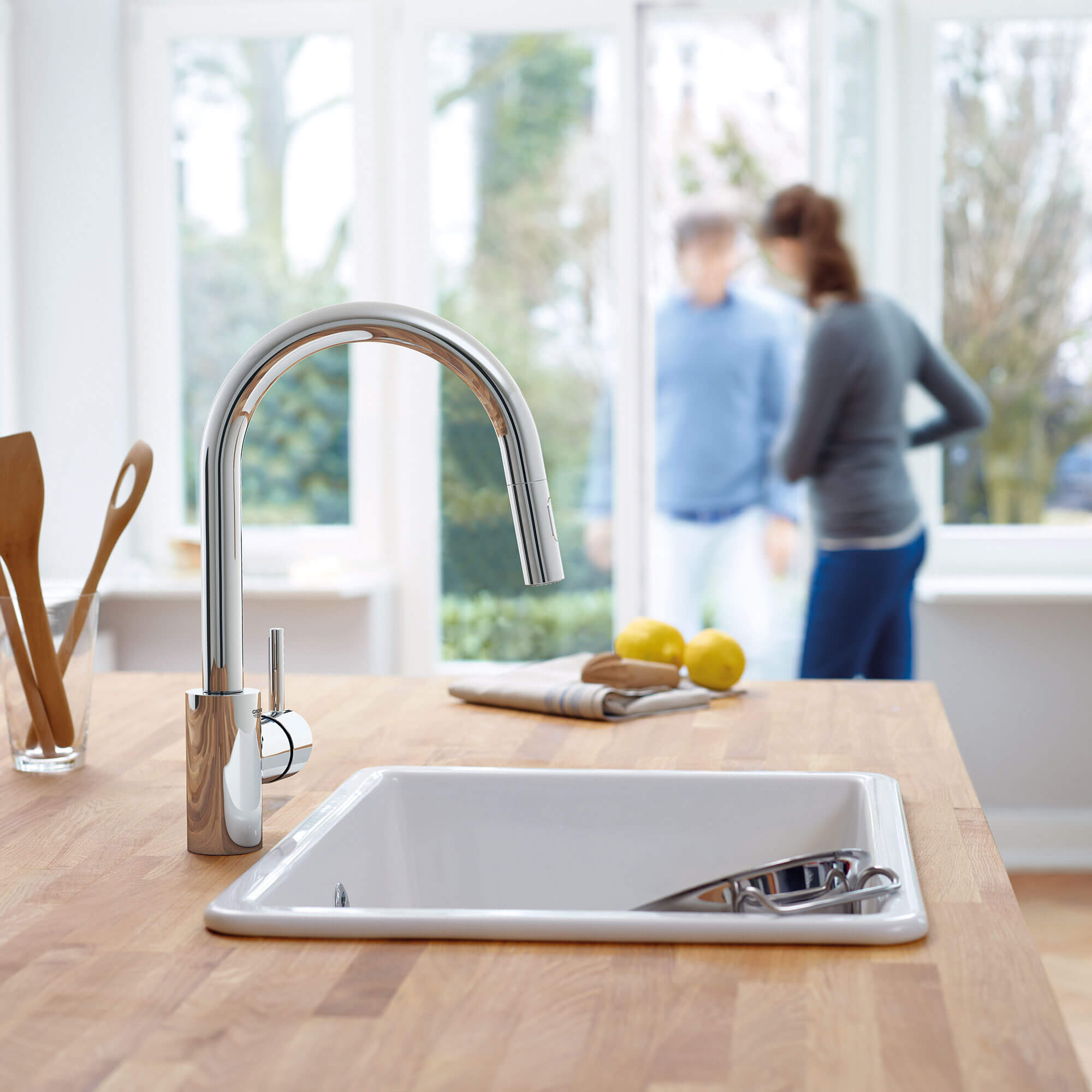 Concetta Kitchen Faucet in Kitchen with People Opening a Door