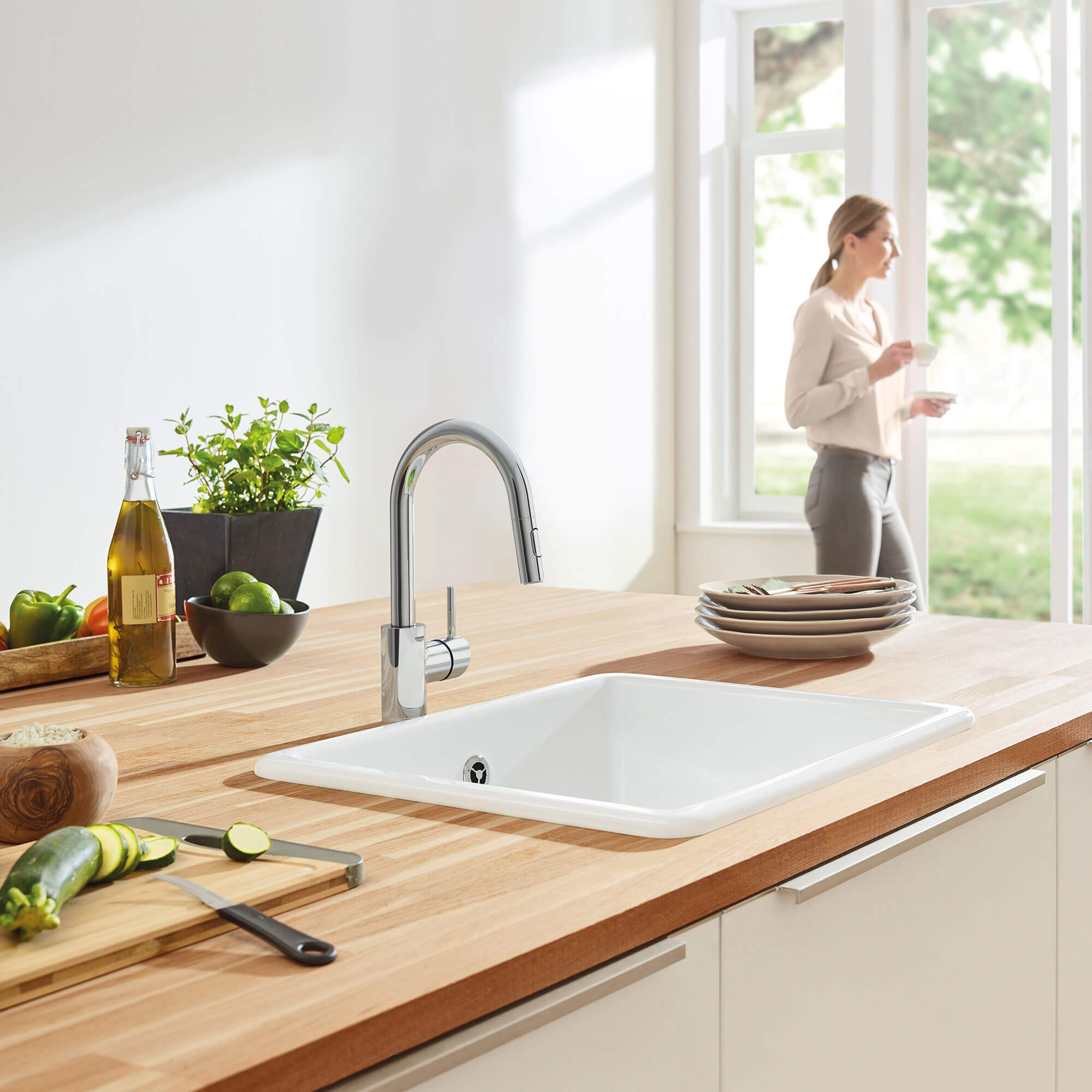 Concetta Kitchen Faucet in Kitchen with Food and a Woman Standing Near a Door