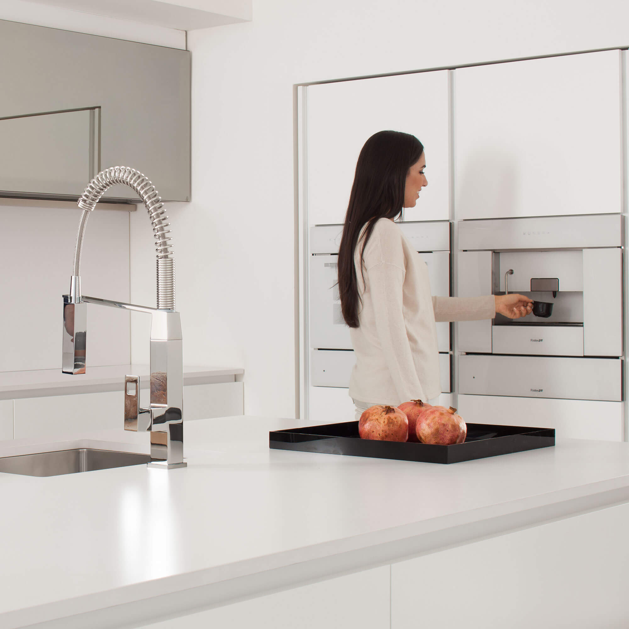 Eurocube kitchen faucet displayed in front of a women.
