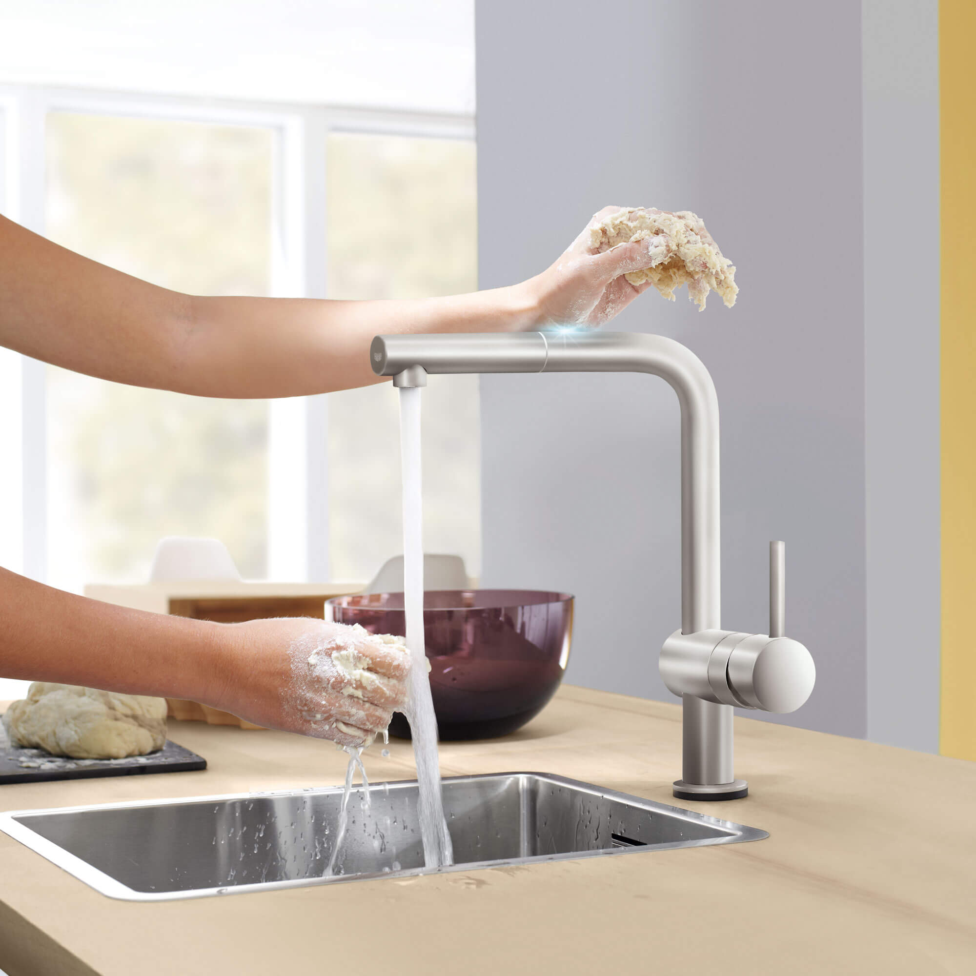 Arm using touch function for Minta Touch kitchen faucet to turn on running water