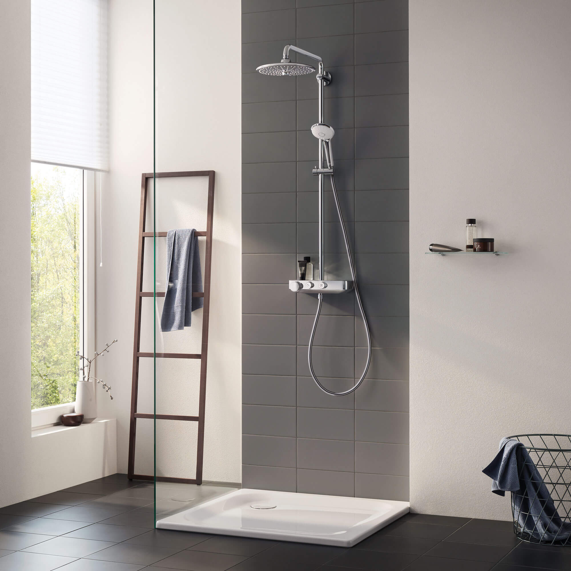 Euphoria smartcontrol shower displayed in a grey toned bathroom.