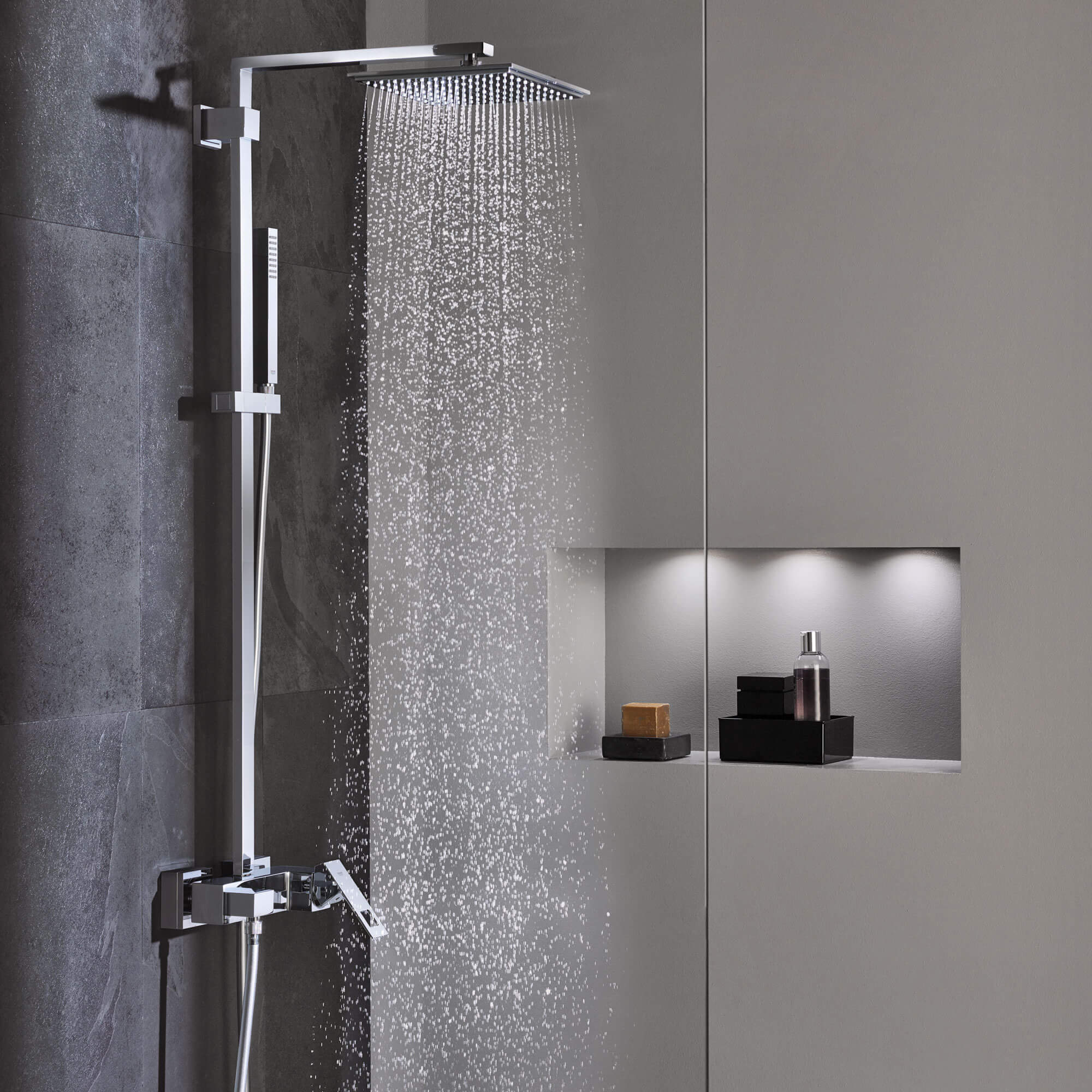 Euphoria cube shower spraying water.