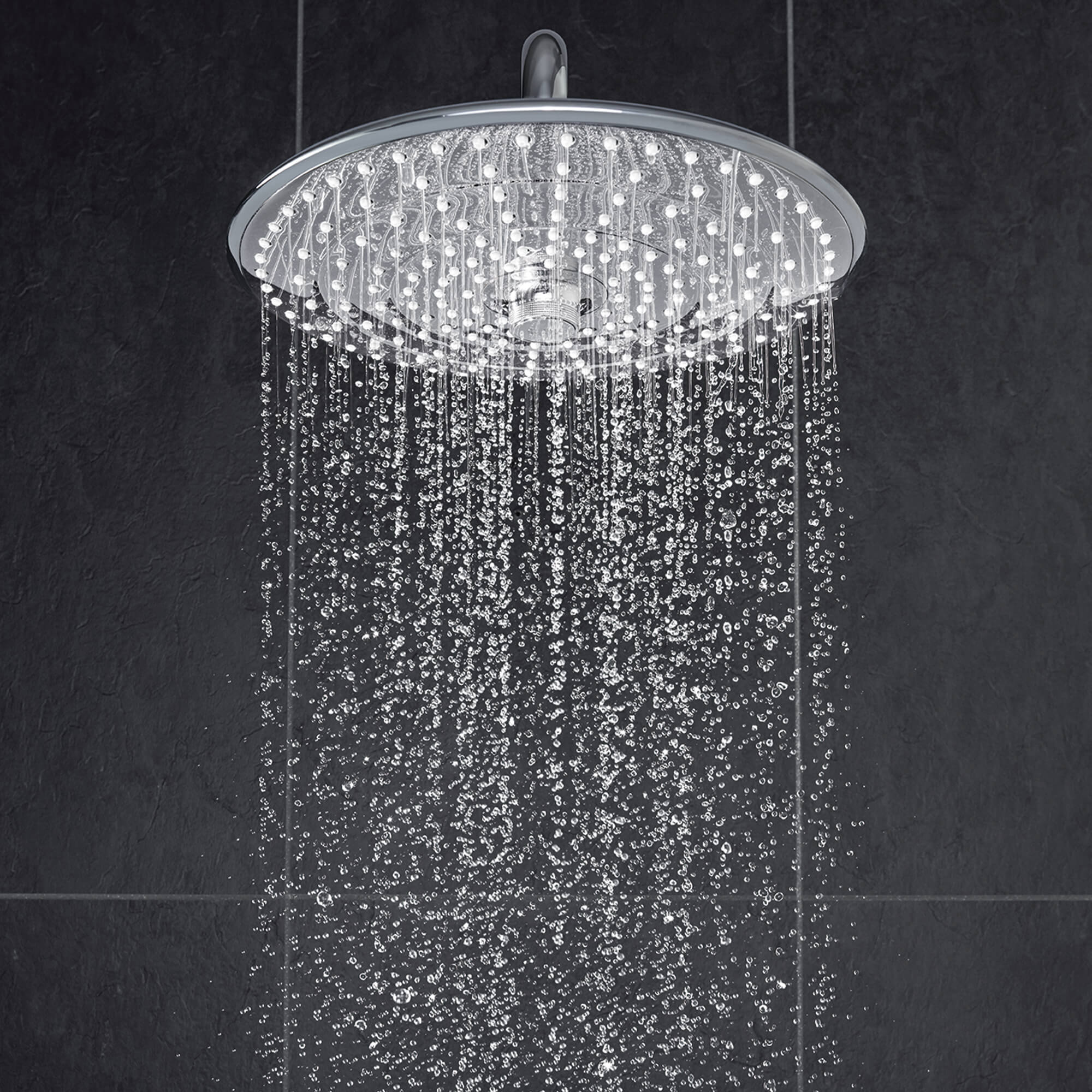 running rain shower from round showerhead