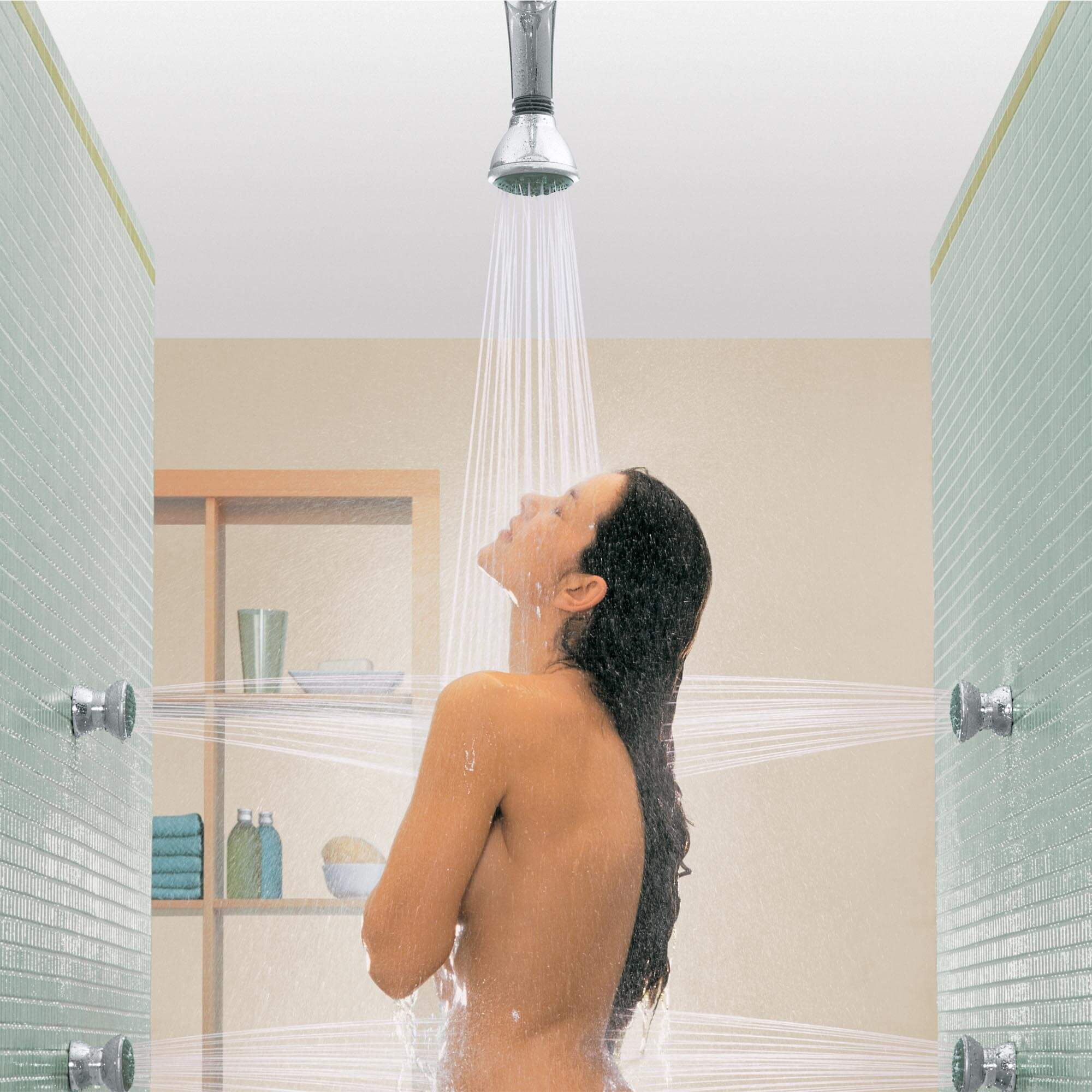 Movario Shower Collection - Woman in shower using ceiling showerhead and wall jet sprays