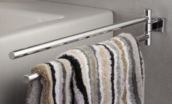 Striped towel on an Essentials cube accessory towel holder.