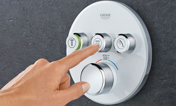 Grohe Smartherm with a person pushing the buttons.