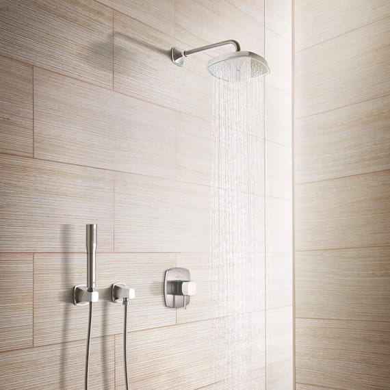 Grandera shower in a bathroom with wooden walls.