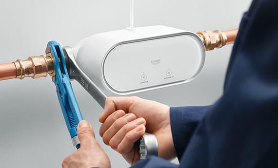 plumber installing Grohe Sense Guard