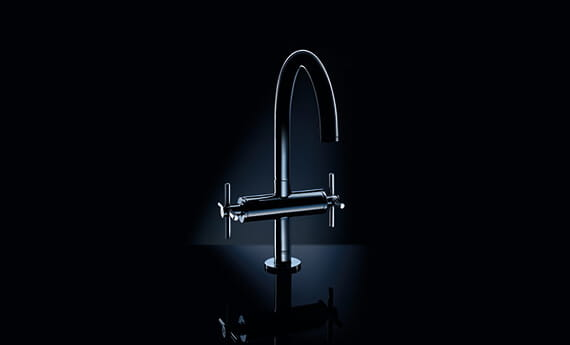 faucet with black background & dimmed lighting