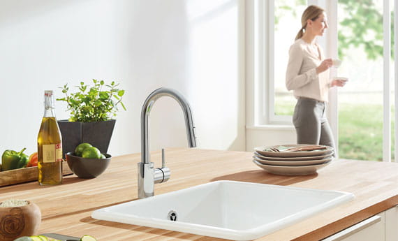 Concetto Single-Handle Kitchen Faucet in Kitchen with Woman Standing near Door